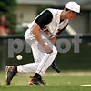Beck Diefenbach  -  bdiefenbach@daily-chronicle.com<br /> <br /> The ball slips past DeKalb's Brian Sisler (22) during the first inning of the game against Kaneland at DeKalb High School in Dekalb, Ill., on Thursday May 20, 2010.