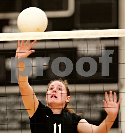 Beck Diefenbach – bdiefenbach@daily-chronicle.com<br /> <br /> Kaneland's Malory Groen (11) returns the ball during the second game against Sycamore at Kaneland High School in Maple Park, Ill., on Tuesday Sept. 21, 2010.