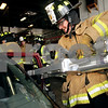 Beck Diefenbach  -  bdiefenbach@daily-chronicle.com<br /> <br /> DeKalb Mayor Kris Povlsen uses a pneumatic splitter to separate a door from a car during a mock extraction at Fire Ops 101 at Fire Station 1 in DeKalb, Ill., on Monday Aug. 30, 2010. The event was offered to local and state elected officials to experience methods used by fire fighters in response to events such as building fires and car accidents.