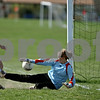 Rob Winner – rwinner@daily-chronicle.com<br /> <br /> Sycamore's Lauren Miller (left) puts one past Hinckley-Big Rock goalie Jessica Leifheit during the second half of their game on Saturday April 17, 2010 in DeKalb, Ill. for Barbfest.