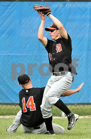 Beck Diefenbach  -  bdiefenbach@daily-chronicle.com<br /> <br /> DeKalb's Jake Gordon (10, right) and Frank Petras (14, left) nearly collide as Gordon makes the catch during the fourth inning of the game against Geneva at Geneva High School in Geneva, Ill., on Thursday May 13, 2010. DeKalb defeated Geneva 5 to 3.