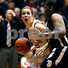 Rob Winner – rwinner@daily-chronicle.com<br /> DeKalb's Shelby Wood looks to the basket as Kaneland's Trinae Coachman provides defense during the first half of their game in DeKalb on Friday January 22, 2010.