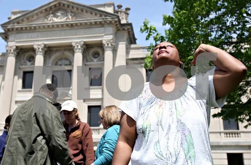 Rob Winner – rwinner@daily-chronicle.com<br /> <br /> Yakisha Merritt, of DeKalb, breaks away from her prayer circle for a moment during the National Day of Prayer outside the DeKalb County Court House in Sycamore, Ill. on Thursday May 6, 2010.