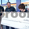 Dana Herra - dherra@daily-chronicle.com<br /> <br /> Illinois Lottery Acting Superintendent Jodie Winnett presents Ron Steger of DeKalb with an oversized check for $4.5 million, the amount Steger won in a Lottery jackpot in September. Steve Wargo, manager of the Road Ranger gas station in DeKalb where Steger bought the ticket, looks on.