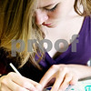 Rob Winner – rwinner@daily-chronicle.com<br /> <br /> Autumn Shippy, 16, works on an artist trading card at Sycamore High School in Sycamore, Ill. on Friday May 21, 2010.
