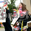Beck Diefenbach  -  bdiefenbach@daily-chronicle.com<br /> <br /> Dressed as a trash can Kristi Potuznik, 8, of Cortland, rallies against the expansion of the landfill before the DeKalb County Board approved the resolution at the DeKalb County Legislative Center in Sycamore, Ill., on Monday May 10, 2010. Potuznik was a student at the new Cortland Elementary School until her mother, Bard Potuznik took her out and enrolled her in a private school.