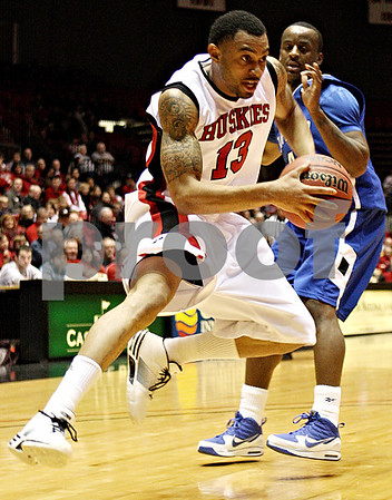 Rob Winner – rwinner@daily-chronicle.com<br /> NIU's Xavier Silas (front) moves past Buffalo defender Rodney Pierce on his way to the basket during the first half on Saturday January 30, 2010 at the Convocation Center in DeKalb, Ill.