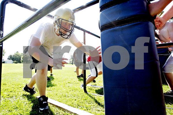 Rob Winner – rwinner@daily-chronicle.com<br /> <br /> Devin Thevenot runs through drills with his teammates during the Hawks' morning practice on Thursday August 12, 2010 in Kirkland, Ill.