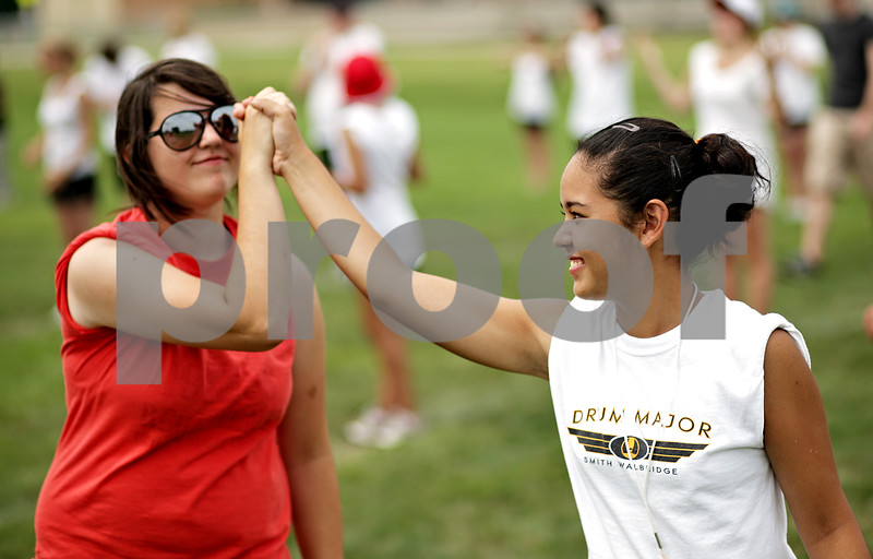 Beck Diefenbach  -  bdiefenbach@daily-chronicle.com<br /> <br /> Drum major Somali Wilson (right) high-fives junior Hillary Ulman during DeKalb High School's band camp at Clinton Rosette Middle School in DeKalb, Ill., on Monday August 2, 2010.