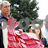 Rob Winner – rwinner@daily-chronicle.com<br /> <br /> Michelle Christensen (from left to right), Al Brinkman, and Amanda Christensen, all of DeKalb, hold up a red blanket against child abuse during the Hands Around the Courthouse event on Thursday April 29, 2010. This annual event at the DeKalb County Courthouse in Sycamore, Ill. hopes to bring awareness to child abuse.