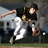 Beck Diefenbach  -  bdiefenbach@daily-chronicle.com<br /> <br /> Sycamore's Nick Bridge (9) fields a ground ball  during the first inning of the game against DeKalb at DeKalb High School in DeKalb, Ill., on Friday April 9, 2010.