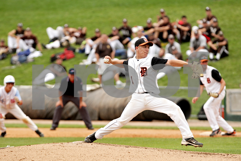 Beck Diefenbach  -  bdiefenbach@daily-chronicle.com<br /> <br /> DeKalb's Jake Lemay winds up during the first inning of the IHSA Class 3A State Semifinal Game against Marian Central in Joliet, Ill., on Friday June 11, 2010.