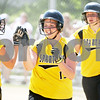 Rob Winner – rwinner@daily-chronicle.com<br /> <br /> (From left to right) Sycamore's Samantha Navarro (8) greets teammates Katie Jones and Brittany Huber after the two scored on a hit by Anna Buzzard (not pictured) in the second inning of the IHSA Class 3A Sycamore Regional championship game on Saturday May 29, 2010 in Sycamore, Ill. Sycamore went on to defeat Kaneland, 6-3.