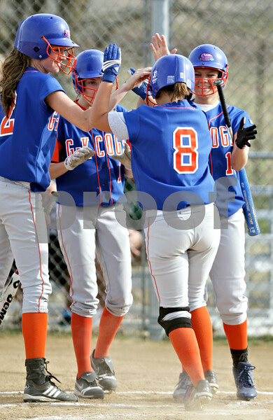 Beck Diefenbach  -  bdiefenbach@daily-chronicle.com<br /> <br /> Genoa-Kingston's Kelsie Campbell (2, far left), Emily Wakeley (1, second from left) and Ashley Miller (11, far right) congratulate Laura Volkening (8, second from right) following her two-run home run during the top of the first inning of the game against Sycamore at Sycamore High School in Sycamore, Ill., on Thursday April 1, 2010. G-K defeated Sycamore 9 to 2.