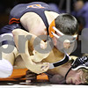 Rob Winner – rwinner@daily-chronicle.com<br /> <br /> DeKalb's Jake Jones (top) takes Kaneland's Sonny Horn to the mat during their 125-pound match at DeKalb on Thursday night. Jones would eventually pin Horn.
