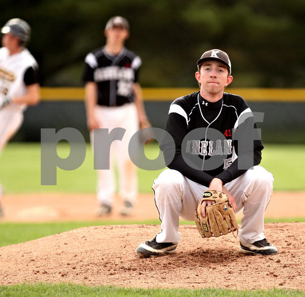 Beck Diefenbach  -  bdiefenbach@daily-chronicle.com<br /> <br /> Kaneland's Ty Hamer (5) waits on the mound after walking a Sycamore batter during the third inning of the game at Kishwuakee College in Malta, Ill., on Friday May 14, 2010.
