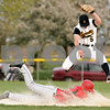Beck Diefenbach  -  bdiefenbach@daily-chronicle.com<br /> <br /> Sycamore's Eric Ray (5, top) leaps as Indian Creek's Matt Korhnak (18) slides safe into second base during the sixth inning of the game at Sycamore Park in Sycamore, Ill., on Monday April 19, 2010. Sycamore defeated Indian Creek 10 to 3.