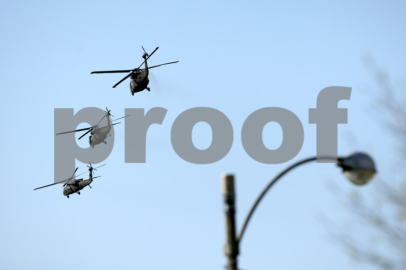 Beck Diefenbach  -  bdiefenbach@daily-chronicle.com<br /> <br /> National Guard helicopters fly Northern Illinois University in DeKalb, Ill., on Friday April 16, 2010.
