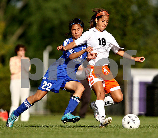 Beck Diefenbach  -  bdiefenbach@daily-chronicle.com<br /> <br /> DeKalb's Lizzy Conejo (18, right) keeps the ball away from Burlington Central's Camille Dela Cruz (22) during the second half of the game at Rochelle Township High School in Rochelle, Ill., on Tuesday May 18, 2010. DeKalb defeated Burlington Central 4 to 2.