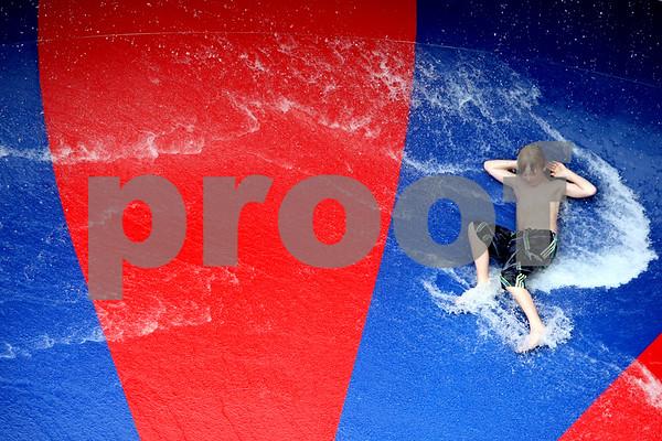 Rob Winner – rwinner@daily-chronicle.com<br /> <br /> On Thursday July 15, 2010, Genoa resident Conner Makoben, 11, goes down one of the water slides at the Chamberlain Park Pool in Genoa, Ill.