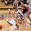Beck Diefenbach  -  bdiefenbach@daily-chronicle.com<br /> <br /> Hampshire's Cassie Dumoulin(24,center) and DeKalb's Emily Bemis (22, right) go after a loose ball during the first quarter of the IHSA Class 3A Regional championship game at Rochelle Township High School in Rochelle, Ill., on Thursday Feb. 18, 2010.