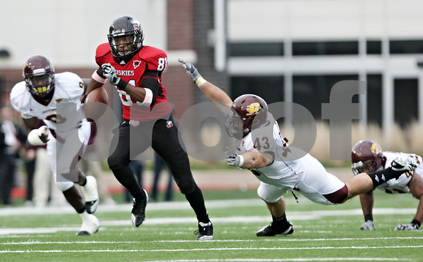 Rob Winner – rwinner@daily-chronicle.com<br /> <br /> Northern Illinois wide receiver carries the ball for more yards after a catch during the second quarter in DeKalb, Ill. on Saturday October 23, 2010. DeKalb went on to defeat Central Michigan, 33-7.