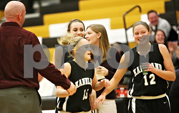 Rob Winner – rwinner@daily-chronicle.com<br /> <br /> Kaneland's Lexee Guerra (15) is greeted by the Knights' bench after hitting a shot at the end of the first half on Friday December 10, 2010 in Sycamore, Ill.