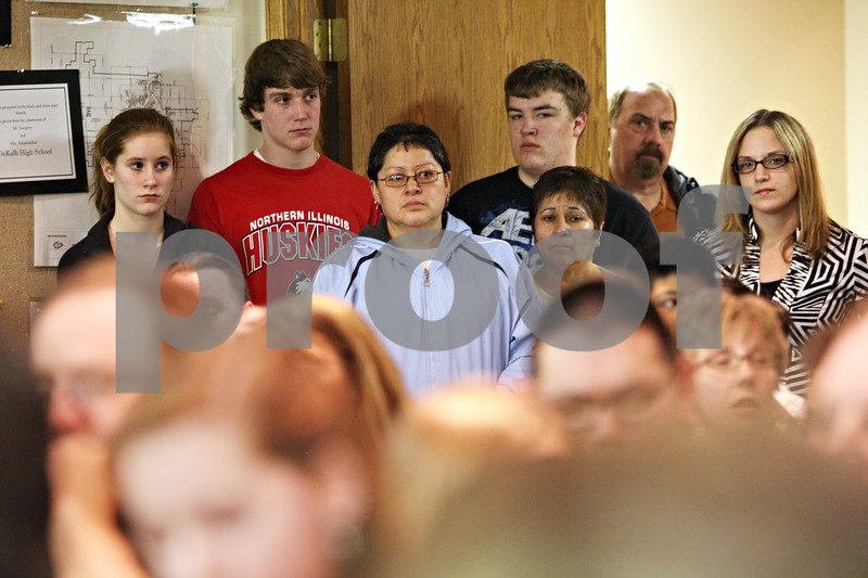 Beck Diefenbach  -  bdiefenbach@daily-chronicle.com<br /> <br /> Overflow of attendants stand in the doorway and hallway of the board room during the DeKalb School District 428 board meeting at the Education Center in DeKalb, Ill., on Tuesday March 16, 2010.