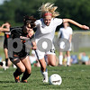 Beck Diefenbach  -  bdiefenbach@daily-chronicle.com<br /> <br /> Freeport's Ali Reedy (16, left) and Sycamore's Rachel Stueber (22, right) battle for the ball during the second half of the IHSA Class 2A sectional final game at Hampshire High School in Hampshire, Ill., on Friday May 28, 2010.