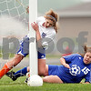 Beck Diefenbach/ The Daily Chronicle bdifeenbach@daily-chronicle.com<br /> <br /> Genoa-Kingston Shannon Schumacher (28, left) slams into the post as her shot rolls in for a goal during the first half of the game against Galena/River Ridge at G-K High School in Genoa, Ill., on Tuesday May 11, 2010. Schumacher was able to walk off the field under he own power. G-K defeated Galena/River Ridge 8 to 1.