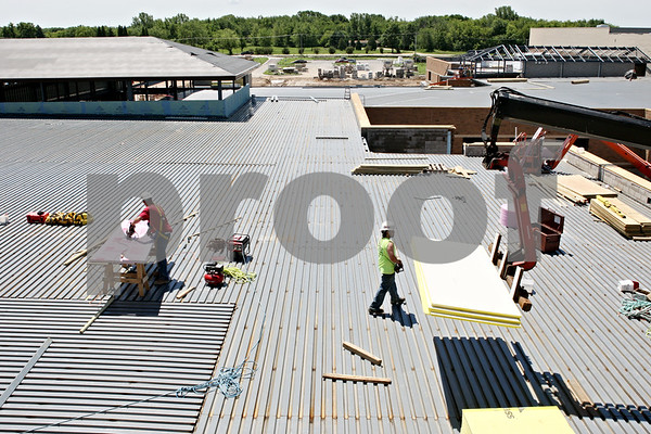 Rob Winner – rwinner@daily-chronicle.com<br /> <br /> Construction crews work on top of the roof at the new DeKalb High School in DeKalb, Ill. on Wednesday June 9, 2010.