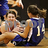 Beck Diefenbach  -  bdiefenbach@daily-chronicle.com<br /> <br /> DeKalb's Emily Bemis (22, left) and Geneva Kat Yelle (14) fight for the ball during the third quarter of the game at DeKalb High School, in DeKalb, Ill., on Friday Jan. 5, 2010. Geneva defeated DeKalb 44 to 41.