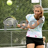 Beck Diefenbach - bdiefenbach@daily-chronicle.com<br /> <br /> Sycamore's Mary Stang returns the ball during doubles practice at Sycamore High School in Sycamore, Ill., on Tuesday Aug. 17, 2010.