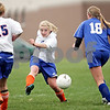 Beck Diefenbach  -  bdiefenbach@daily-chronicle.com<br /> <br /> Genoa-Kingston's Courtney Seisser (34, left) kicks the ball during the second half of the game against Galena/River Ridge at G-K High School in Genoa, Ill., on Tuesday May 11, 2010. G-K defeated Galena/River Ridge 8 to 1.