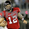 Rob Winner – rwinner@daily-chronicle.com<br /> <br /> Northern Illinois quarterback Chandler Harnish carries the ball during the third quarter in DeKalb, Ill. on Saturday September 11, 2010. Northern Illinois went on to defeat North Dakota, 23-17.