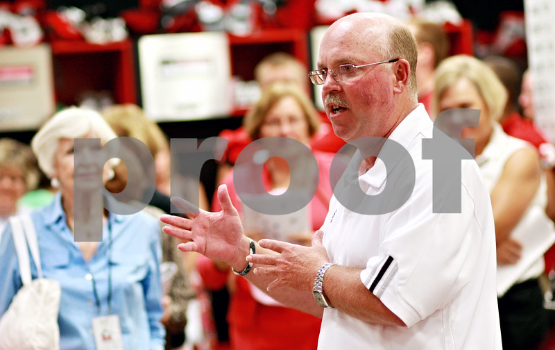 Chronicle File Photo<br /> <br /> Head coach Jerry Kill gives a pep talk to participants during the Northern Illinois University football 101 women's clinic at Huskie Stadium in DeKalb, Ill., on Tuesday July 27, 2010.