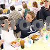 Beck Diefenbach  -  bdiefenbach@daily-chronicle.com<br /> <br /> Linda Maffei (center), of DeKalb, helps her daughter Chrissy Cowan (left) with her meal during the biweekly VAC community dinner at the Senior Services Center in DeKalb, Ill., on Wednesday March 31, 2010.