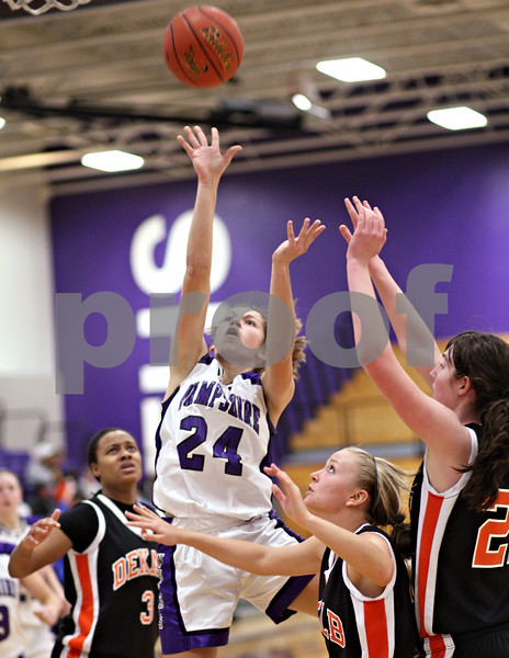Beck Diefenbach  -  bdiefenbach@daily-chronicle.com<br /> <br /> Hampshire's Cassie Dumoulin (24, top) shoots the ball over DeKalb's Michelle Todd (3, left), Kay Smith (13, second from right) and Emily Bemis (22, far right) during the third quarter of the IHSA Class 3A Regional championship game at Rochelle Township High School in Rochelle, Ill., Thursday Feb. 18, 2010.