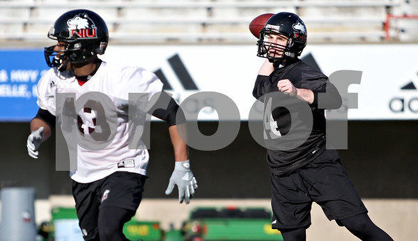 Rob Winner – rwinner@daily-chronicle.com<br /> <br /> Jordan Lynch (right) drops back to pass during NIU football practice on Tuesday March 23, 2010 in DeKalb, Ill.