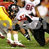 Beck Diefenbach  -  bdiefenbach@daily-chronicle.com<br /> <br /> Northern Illinois tight end Jason Schepler (87, right) tackles Iowa State line backer Floyd Mattison (19) following an interception by ISU during the second quarter of the game at Jack Trice Stadium on the campus of Iowa State University in Ames, Iowa, on Thursday Sept. 2, 2010. Iowa State defeated Northern Illinois 27 to 10.