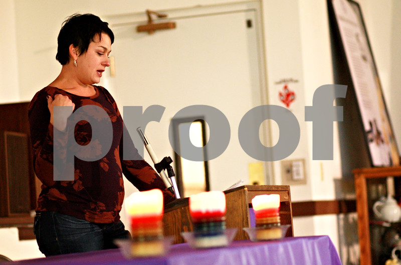 Beck Diefenbach – bdiefenbach@daily-chronicle.com<br /> <br /> Sarah Banbury speaks about her experience of being assaulted by her husband during Safe Passage's annual candle light vigil at the DeKalb Area Women's Center in DeKalb, Ill., on Monday Oct. 4, 2010.