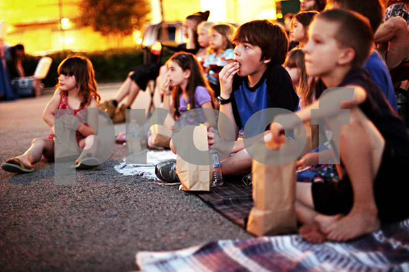 """Beck Diefenbach  -  bdiefenbach@daily-chronicle.com<br /> <br /> Spencer Hoffman-Edminster, 12, of Cortland, watches """"Goonies"""" for the first time during the Summer on State event in Sycamore, Ill., on Thursday July 15, 2010."""