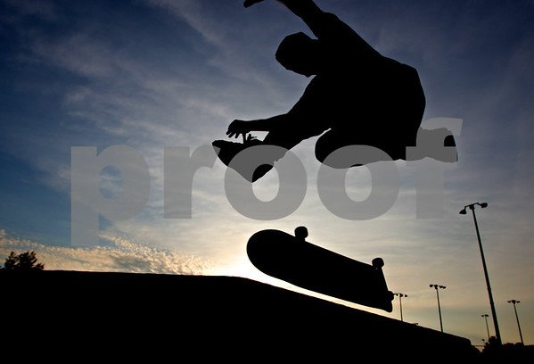 Beck Diefenbach  -  bdiefenbach@daily-chronicle.com<br /> <br /> Pat Buckley, 22, of DeKalb, practices at the skate park in Katz Park in DeKalb, Ill., on Wednesday July 14, 2010.