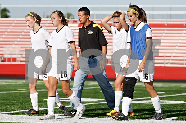 Rob Winner – rwinner@daily-chronicle.com<br /> <br /> (From left to right) Sycamore's Jenna Johnson, Sarah Papini, Dave Lichamer, Katelyn Brown, and Katie Bolander leave the pitch at the end of the first half of the IHSA Class 2A Barrington Super-Sectional on Tuesday June 1, 2010 in Barrington, Ill. Saint Viator defeated Sycamore, 3-0.