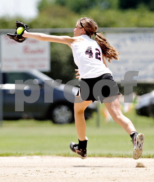 Rob Winner – rwinner@daily-chronicle.com<br /> <br /> Kishwaukee Valley Storm shortstop Kelsie Campbell makes a backhanded catch during their 16U bracket game against the McHenry County Heatwave Black at the Storm Dayz softball tournament on Saturday June 26, 2010 in Sycamore, Ill.
