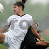 Rob Winner – rwinner@daily-chronicle.com<br /> <br /> Sycamore's Emma Norris (left) and DeKalb's Lizzy Conejo go up for a ball during the first half of their game at Barbfest on Saturday April 24, 2010 in DeKalb, Ill.