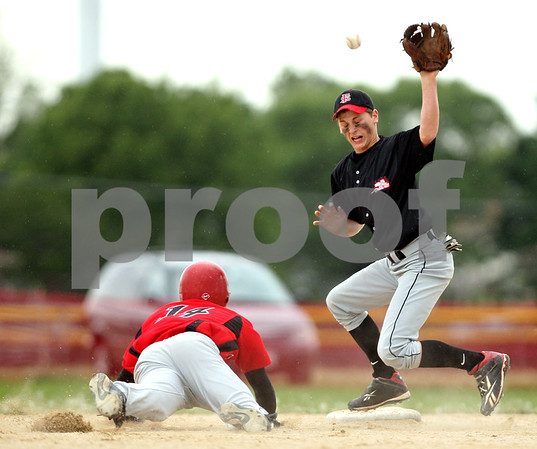 Beck Diefenbach  -  bdiefenbach@daily-chronicle.com<br /> <br /> Indian Creek's Josh Johnson (14) slides safe into second base as Fulton's Travis VanZuiden (10) misses the catch during the fifth inning of the game at Indian Creek High School in Shabbona, Ill., on Monday May 17, 2010.