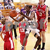 Beck Diefenbach  -  bdiefenbach@daily-chronicle.com<br /> <br /> Hiawatha's Catron Puckett (22, center) is covered by LaMoille's Austin Schwingle (3, right) during the fourth quarter of the Little Ten Tournament first round game at Somonaulk High School in Somonaulk, Ill., on Monday Feb. 1, 2010.