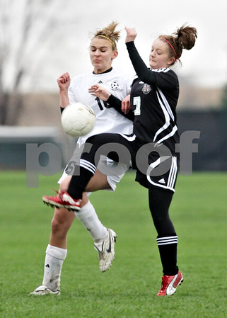 Beck Diefenbach  -  bdiefenbach@daily-chronicle.com<br /> <br /> Kaneland's Savannah Webb (16, left) battles Indian Creek's Samantha Meredith (7) for the ball during the first half of the game at Kaneland High School in Maple Park, Ill., on Wednesday April 7, 2010. Kaneland defeated Indian Creek 7 to 0.