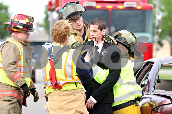 Rob Winner – rwinner@daily-chronicle.com<br /> <br /> During an accident simulation at Indian Creek High School in Shabbona, Ill. on Friday April 30, 2010, junior David Drendel is helped by Shabbona firefighters after being removed from a vehicle.